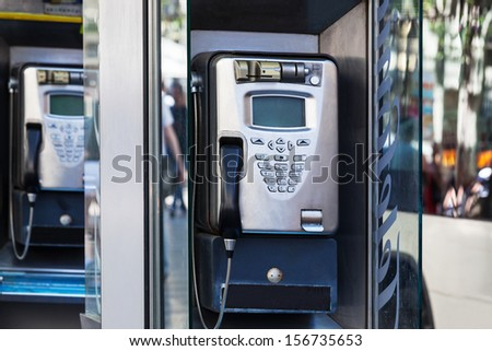 modern payphone on a city street - stock photo
