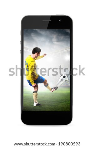 modern phone with soccer or football player shooting a ball on screen - stock photo