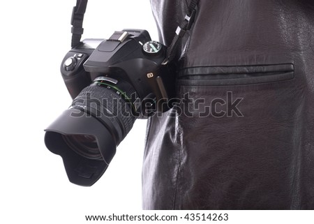 Modern photo SLR camera hanging on the shoulder - stock photo