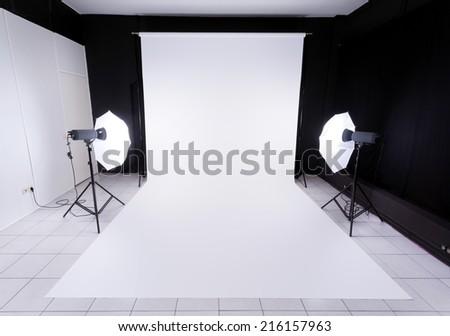 Modern photo studio with lighting equipment - stock photo