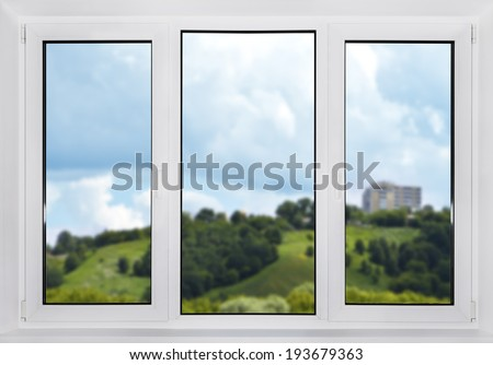 Modern plastic window with views of the countryside. In the focus window. - stock photo
