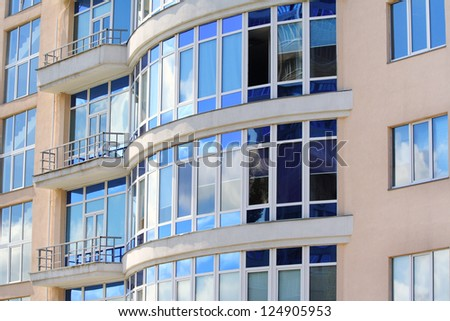 Modern plastic windows on a newly built office building - stock photo