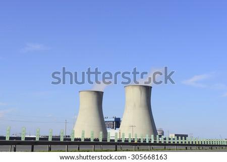 Modern power plants under the blue sky  - stock photo