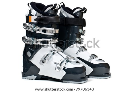Modern professional ski boots isolated on white background - stock photo