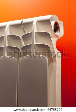 Modern radiator on red - stock photo