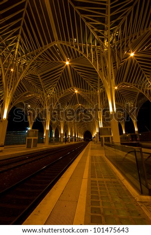 modern railway station Oriente at the expo park in Lisbon at night - stock photo