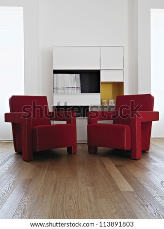 modern re armchair in living room with wood floor - stock photo
