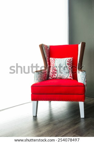 Modern red armchair - stock photo