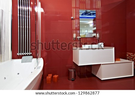 Modern red bathroom interior - stock photo