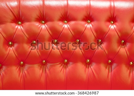 modern red skin texture with rivets - stock photo