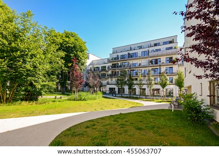 Modern residential building in a green environment, facade of a new residential building in the city - stock photo