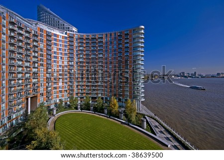 modern residential building on river thames, london - stock photo