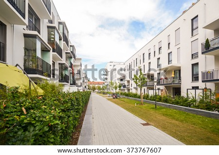 Modern residential buildings with outdoor facilities, Facade of new apartment houses - stock photo
