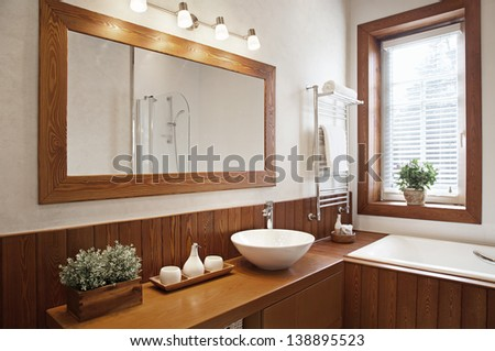 Modern Residential Home Bathroom with large mirror  - stock photo