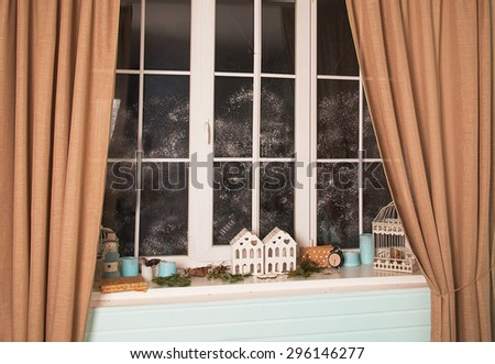 Modern residential window with snow and decor in the studio - stock photo