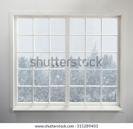 Modern residential window with snow and trees - stock photo