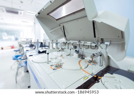 modern robotical machine for centrifuge blood and urine testing closeup - stock photo