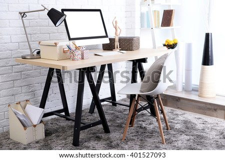 Modern room design. Stylish workplace by the wall. - stock photo