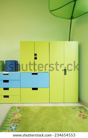 Modern room for child with green furniture and carpet - stock photo