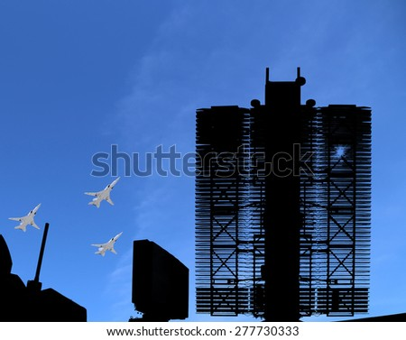 Modern Russian radar and military aircrafts fly in formation against the sky  - stock photo