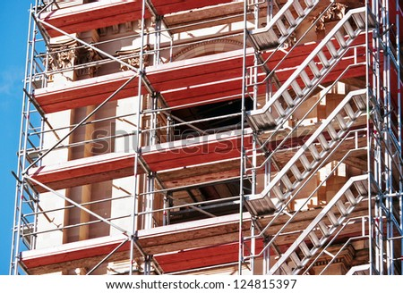 modern scaffolding at a construction site - stock photo