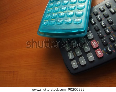 modern scientific calculator on the wooden table - stock photo