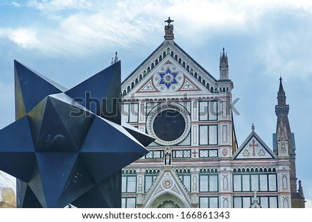 Modern sculpture in front of the church of Santa Croce, Florence, Italy - stock photo