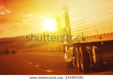 Modern Semi Truck in Motion. American Highway Trucking. Summer on the Highway. - stock photo