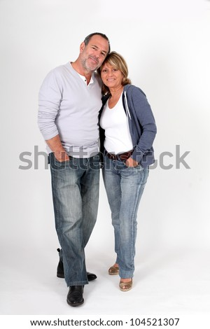 Modern senior couple standing on white background - stock photo