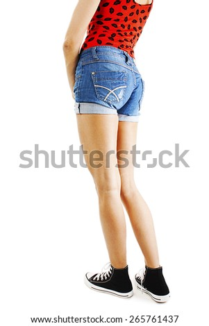 Modern sexy girl in shorts. The model is back. Great ass. Isolated on white background  - stock photo