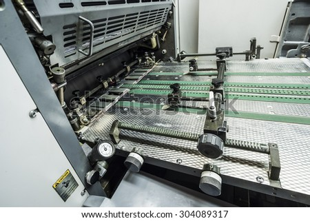 modern sheetfed offset printing machine  - stock photo