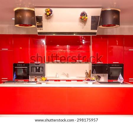 Modern shiny red kitchen  - stock photo