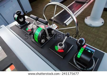 Modern ship control panel on the captains bridge - stock photo