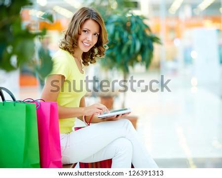 Modern shopper computing on a digital tablet - stock photo