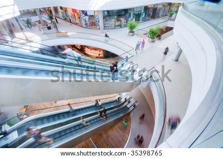 Modern shopping mall. People in rush - stock photo