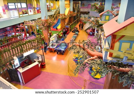 modern shopping mall playground for kids and video games - stock photo