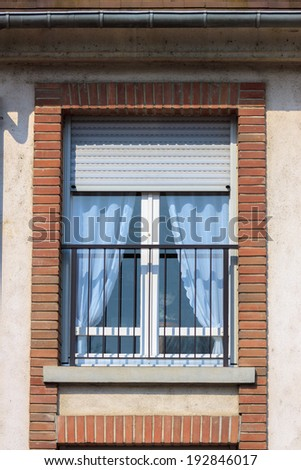 Modern simple window on wall of house - stock photo