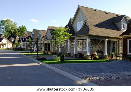 Modern Single Family Homes On A New Street - stock photo