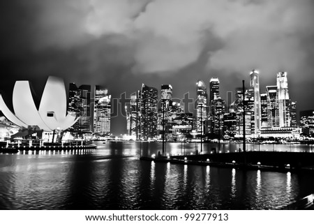 Modern skycrapers along the Singapore river in black and white tone - stock photo