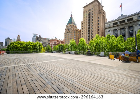 Modern skyline and empty road floor - stock photo