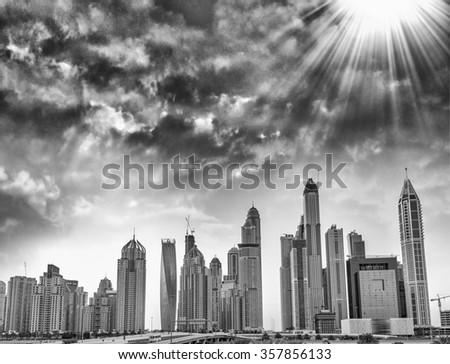 Modern skyline of Dubai Marina. Black and white view. - stock photo
