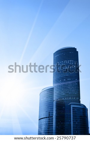 Modern skyscrapers and sun with space for your own text - stock photo