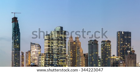 Modern skyscrapers in the business district in the evening light at sunset. - stock photo