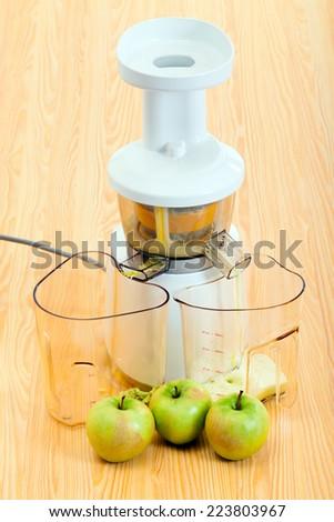 modern slow juicer making apple organic juice - stock photo