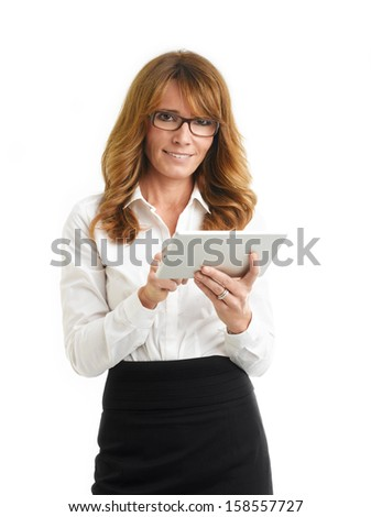 Modern, smiling businesswoman holding tablet in the office. White background. - stock photo