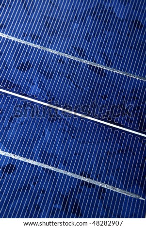Modern solar photo voltaic panel close up with great blue cells details in a perspective view. Great for energy and environment themes. - stock photo
