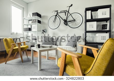Modern space - yellow armchairs in black and white living room - stock photo