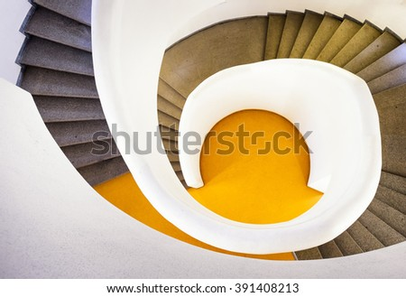 modern spiral staircase - indoors - stock photo