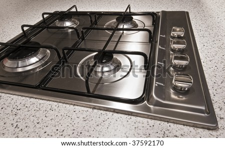 modern stainless steel four ring gas hob - stock photo
