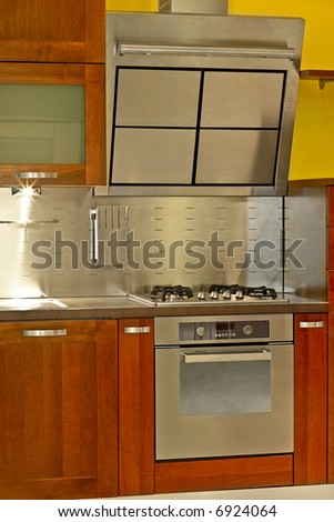 Modern stainless steel stove and kitchen ventilation - stock photo